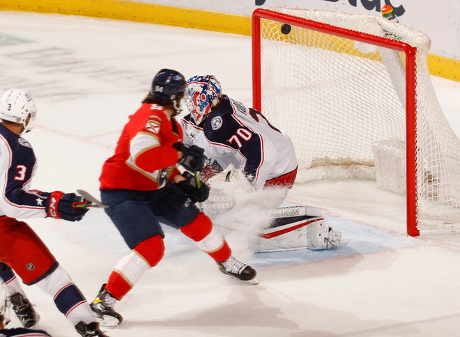 Florida Panthers left wing Ryan Lomberg (94) scores a goal past Columbus Blue Jackets goaltender Joonas Korpisalo (70) during the second period of an NHL hockey game, Tuesday, April 20, 2021, in Sunrise, Fla. (AP Photo/Joel Auerbach)