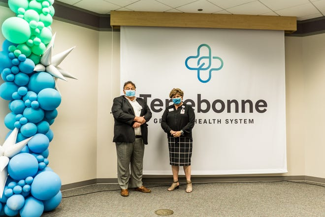 Parish President Gordy Dove and Terrebonne General President and CEO Phyllis Peoples stand in front of the healthcare provider's new logo Wednesday.