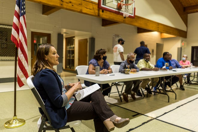 Terrebonne Parish Councilwoman Jessica Domangue (left) answers questions Tuesday night at the Recreation District 8 board meeting at the Donner Gym.