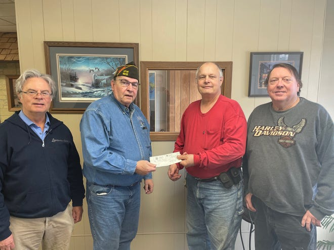 Pictured left to right are George French, Peter Heydt, Oakdale Cemetery Association President Lester Wilkens, and Earl Hill.