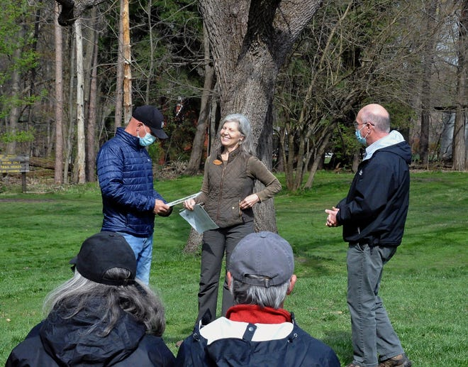 Mark Nussbaum, parks supervisor for the City of Wooster, and Wooster Mayor Robert Breneman accept a plaque from Dr. Joan Maloof, founder and director of the Old Growth Network, This plaque gives Ohio 14 areas in Ohio named to the Old Growth network of trees.