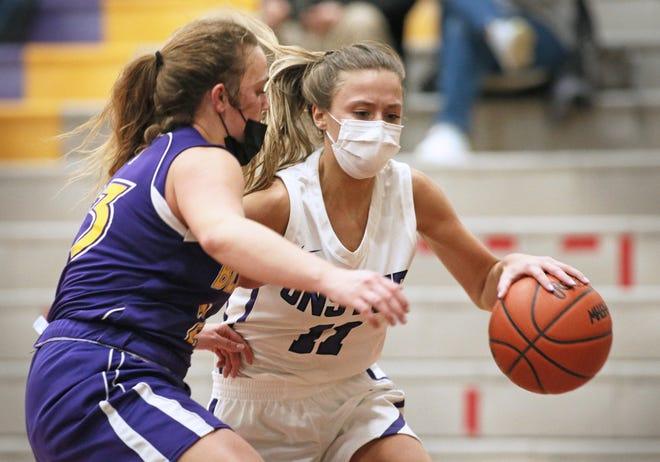 Onsted's Kayla Ross handles the ball while defended by Blissfield's Kara Stutzman during the 2021 season.