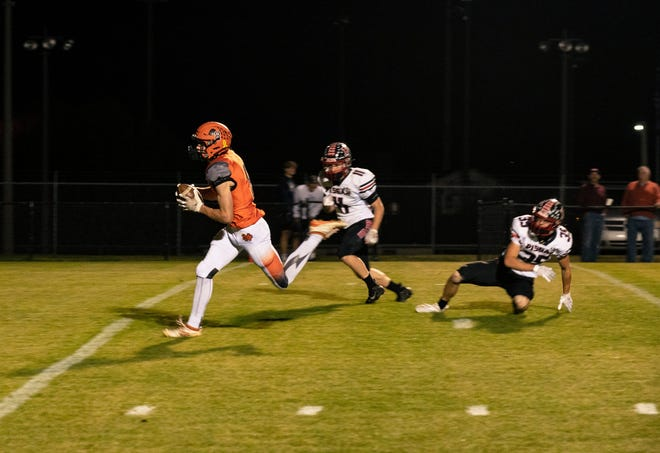 North Davidson's Reid Nisley heads to the end zone for a touchdown against Pisgah. [Luke Johnson for The Dispatch]