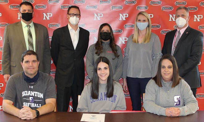 Continuing her academic and softball career at the University of Scranton is senior Madison DeStefano. On hand to witness her commitment to the Royals were (seated, from left): John DeStefano, Madison DeStefano, Lisa DeStefano. Standing: Ron Collins, Principal, Bryan McGraw, Superintendent, Sherri Bour, Softball Coach, Eliza Maganzini, Athletic Director, Dan Powell, Assistant Superintendent.