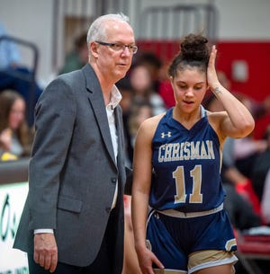 William Chrisman girls basketball coach Scott Schaefer offers instructions to player Gia Moore during a game in the 2019-20 season. Schaefer is stepping down after leading the Bears to their first state final four appearance since 1993 to return to his hometown of Columbus, Nebraska, to help revive that program.