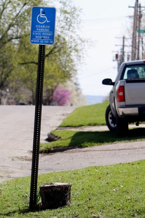 A residential handicapped parking spot Wednesday in Burlington. The city is drafting an official policy that will determine who is eligible for accessible parking spots in front of their homes.