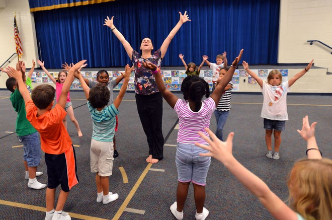 In 2014 Kathryn Thomas teaches yoga to students in extended-day classes at Alimacani Elementary School in Jacksonville. Her then-new nonprofit, Yoga 4 Change, which uses yoga to promote healthy living and foster self-confidence, has since taught healthy living and self-confidence to about 35,000 people.