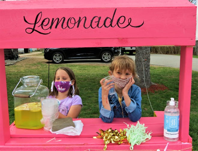 Assisting owner Addison Graciale, right, at her Parker Street lemonade stand is neighbor Annabelle Hill, 6.