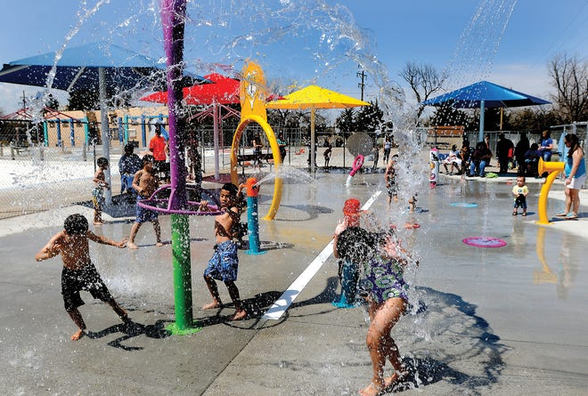 Children get soaked with water while playing on the various features of the spray park at the Big Pool during a past summer. The area will be renovated for use with Garden Rapids.