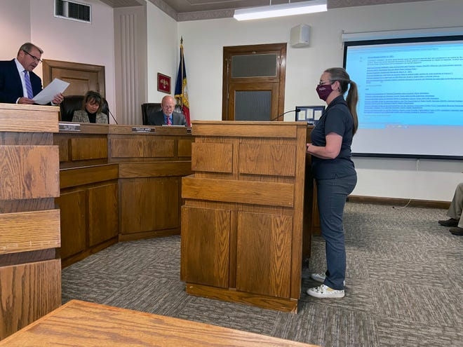Grayson County Judge Bill Magers reads a proclamation about volunteerism as County Family and Community Health Agent Joyce White looks on Tuesday.
