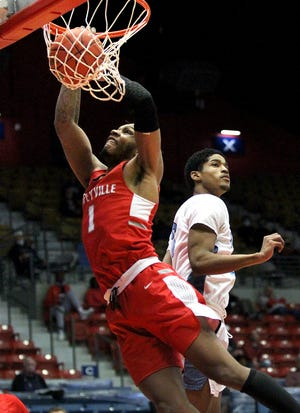 Coffeyville's Larry White (1) dunks the ball past Odessa's Shaman Alston (3) during their NJCAA Men's Div. I Basketball Championship Tournament Tuesday at the Sports Arena. Coffeyville defeated Odessa 95-56.