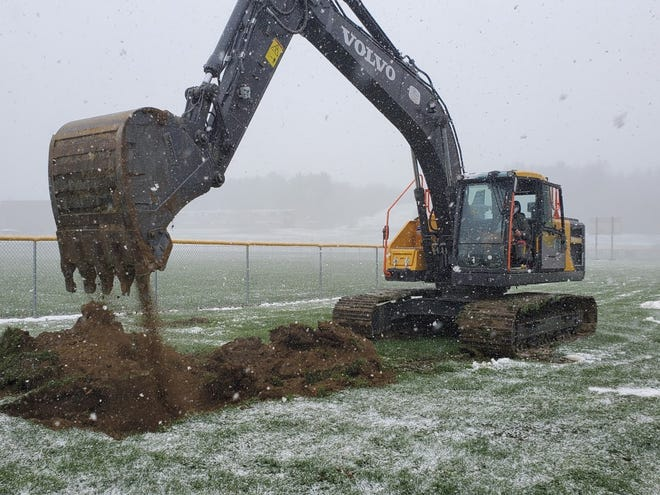 A bulldozer from Bob Bennett Construction begins digging a hole on the site of the new Fairless High School during a groundbreaking ceremony on Wednesday.