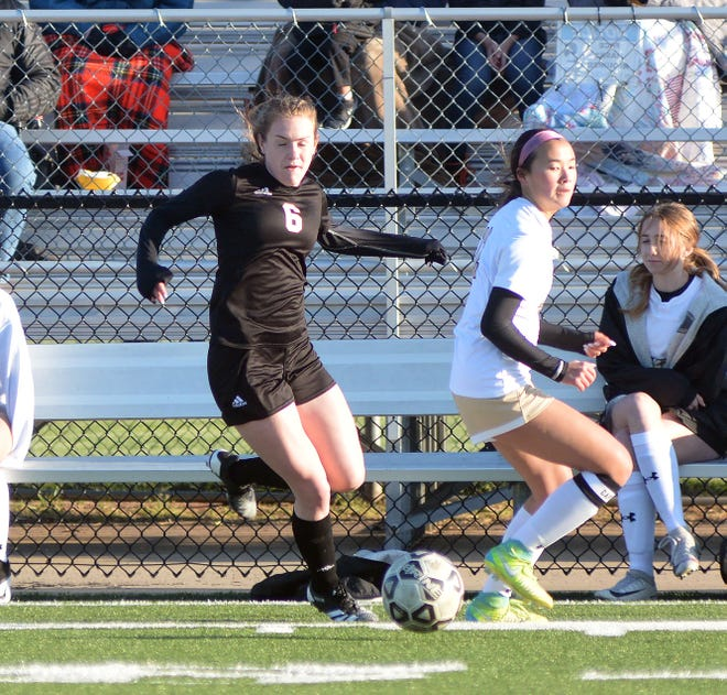 Newton freshman Sophia Houser handles the ball during play Tuesday against Maize South. The Railers fell to the 6-2 Mavericks 6-0 to open league play.