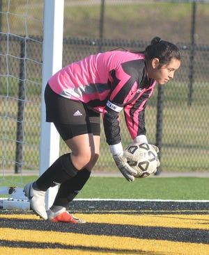 Newton senior goalkeeper Aketzali Solorio-Jimenez makes one of her 16 saves during play Tuesday against Maize South. Newton hosts McPherson Thursday.