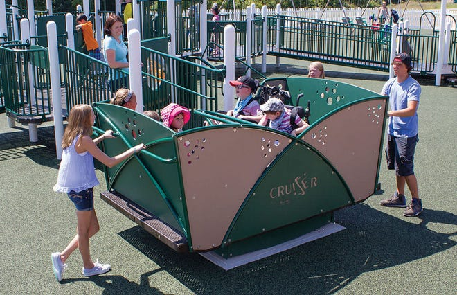 """Slate Creek Elementary is fundraising to add a """"Cruiser,"""" a piece of inclusive/handicap accessable playground equipment, to the school playground."""