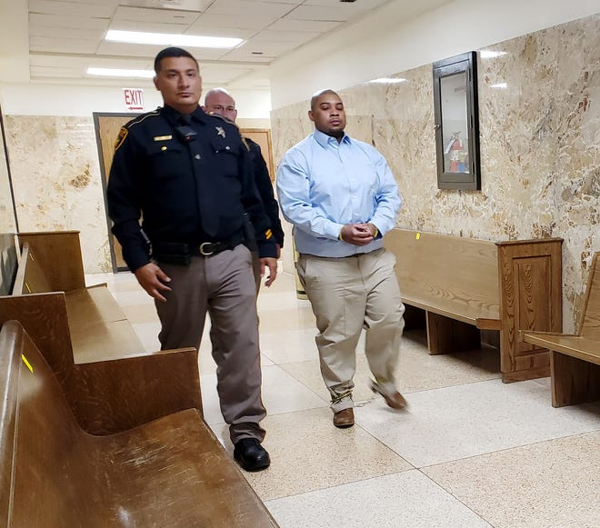 David Delce is escorted out of the 137th District Court after he was sentenced to 25 years in prison for his role in a 2017 armed robbery at a Central Lubbock game room.