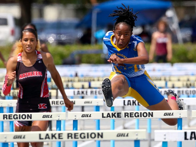 Auburndale senior Tyra Thomas runs to victory in the 100 hurdles on Saturday in the Class 3A, District 7 track and field meet at Lake Region High School. She also won the 300 hurdles, set a personal record in winning the triple jump and took second in the long jump.
