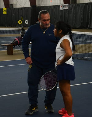 Airport girls tennis coach Jerry Escheck talks with his No. 1 singles player Carly Ferrante between games of a match this season. Escheck, who led the Jets to the first Regional title in school history, has been named Monroe County Region Girls Tennis Coach of the Year.