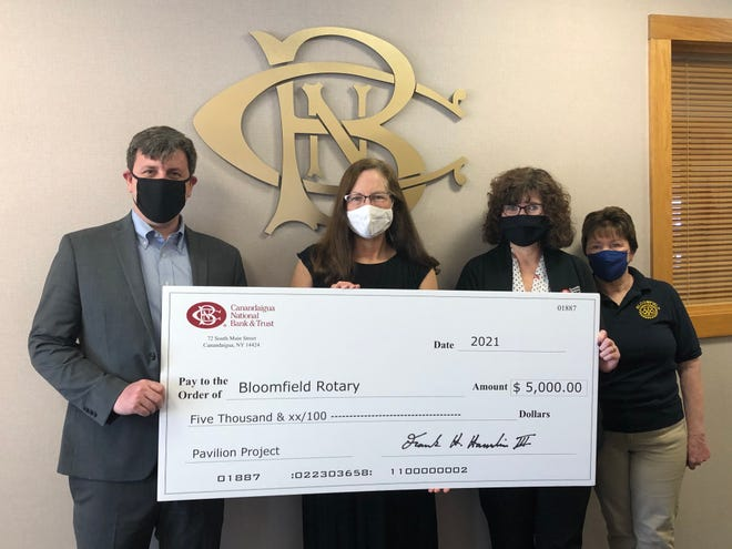 Canandaigua National Bank & Trust supports the Bloomfield Rotary and Lions Club Pavilion Project with a $5,000 donation. Pictured, from left, are Frank Hamlin III, CNB president and CEO; Jaylene Steele, Rotary president; Rotarian Kim Brewer, CNB Bloomfield manager; and Kathleen Conradt, Rotary treasurer.