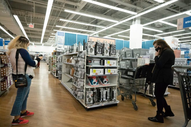Shoppers look at items in Bed, Bath & Beyond in New York on March 25. It can be too easy to overspend on products in the name of self-care. [AP File Photo/Mark Lennihan]