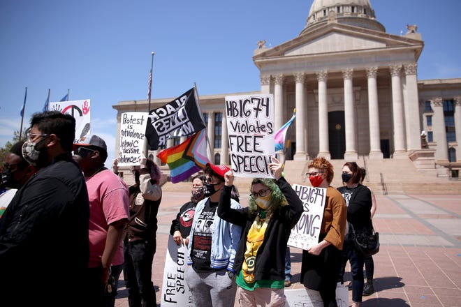 A group of demonstrators speak to the media outside the state Capitol in Oklahoma City, Wednesday, April 21, 2021, while protesting recent bills passed by the Oklahoma Legislature.