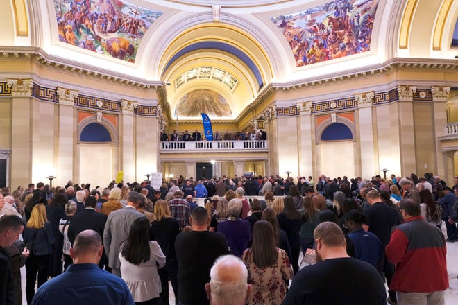 """The crowd fills the fourth floor rotunda on April 20 during a """"Rally for Liberty"""" at the Capitol."""