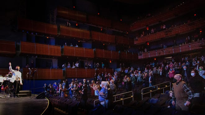The masked and socially distanced audience gives the Oklahoma City Philharmonic a standing ovation at the end of a recent concert at the Civic Center Music Hall.