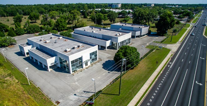 The three buildings at 3949 SW College Road are, from left, the former Volkswagen dealership building,  the BMW dealership building and the Porsche dealership. AdventHealth Ocala recently purchased the 7.26-acre property. Total square footage of the three buildings is 38,588.