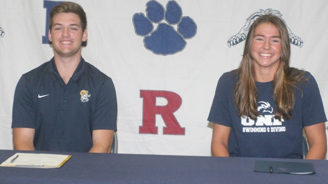 Redeemer Christian's Craigee Breach, left, signed a baseball scholarship with Columbia International University, and Madison Reynolds signed a swimming scholarship with the University of North Florida on Wednesday.