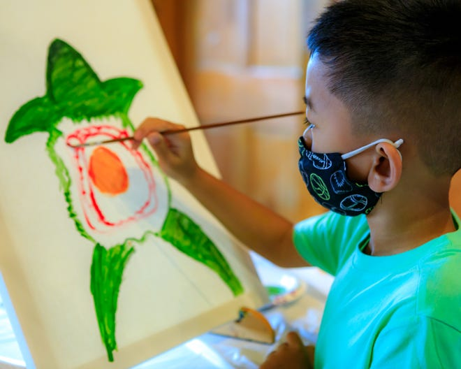 Tyler Chhim, 8 Whitman enjoying a family paint session held at Camp Kiwanee on April 20, 2021.