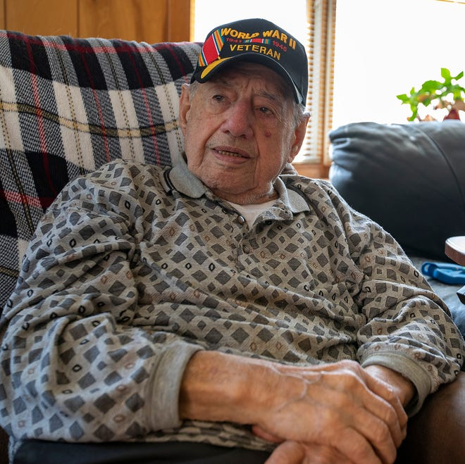 Anthony Grasso, a U.S. Army veteran, at his home in Norwood. The 96-year-old will soon travel to North Carolina to visit the grave of one his battalion members, who was killed in Germany.