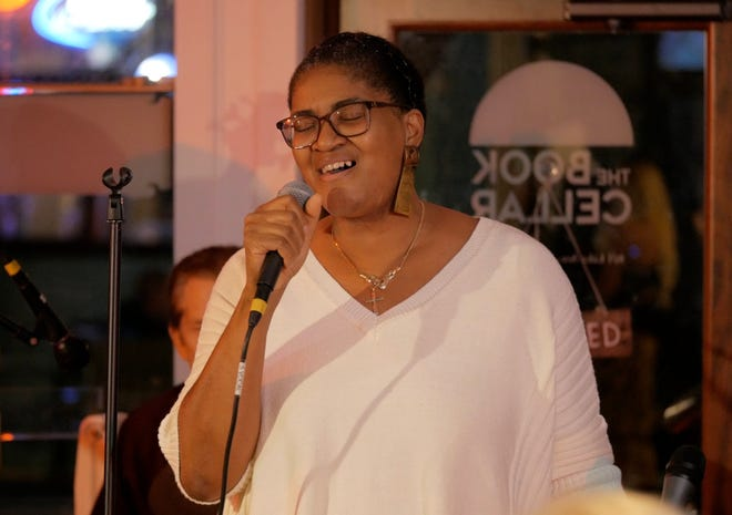 Yvette Norwood-Tiger sings during Jazz on J Street at The Book Cellar in 2019. The singer and founder of the Palm Beach International Jazz Festival brings the event back to the Rinker Playhouse on Saturday. (Wilkine Brutus)