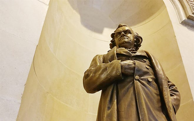 A statue of Stephen Douglas, who was a U.S. Congressman, secretary of state and Supreme Court justice in Illinois, is pictured at the Illinois State Capitol Wednesday. The statue remains on the Statehouse's second floor, although a different statue of Douglas was removed from the Capitol grounds last year by former House Speaker Michael Madigan. A task force met Wednesday to review all monuments on state property.