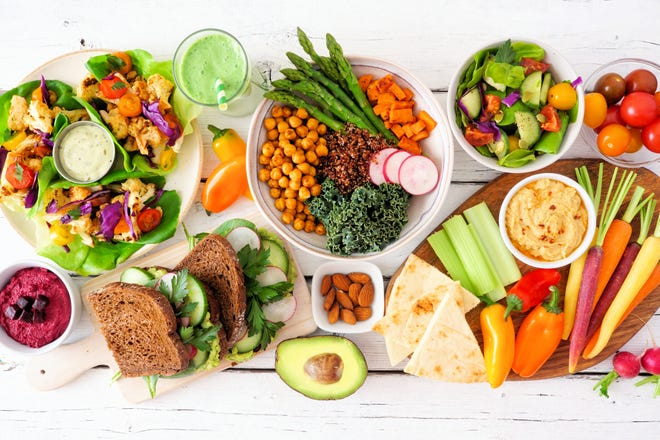 A plant-based diet includes healthy dishes like lettuce wraps, Buddha bowls, vegetables, sandwiches, and salads.