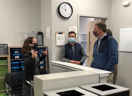 Sandra Pierce-Jordan, executive dDirector at The Birchtree Center, shows Gov. Chris Sununu and Jonathan Melanson, director of appointments and liaison to the Executive Council, a school store at The Birchtree Center's new facility in Portsmouth. Birchtree's students with autism will serve as clerks in the store as part of their vocational training.
