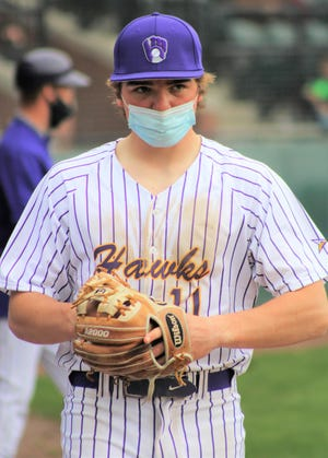 Marshwood senior pitcher Reed Smaracko prepares to enter the game in the fifth inning of Tuesday's 13-inning game against Sanford. Smaracko allowed seven hits, two runs, four walks and struck out eight batters in 8 1/3 innings of relief.