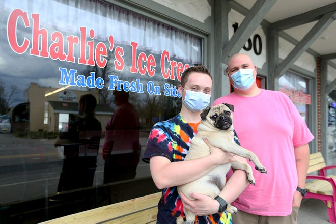 Owners Lucas and Doug Hanson with their dog, Charlie, namesake of the ice cream shop the father and son are opening in Exeter.