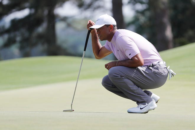Thanks to GolfLogix, the average person should be able to read the greens as well as Tiger Woods, who's measuring a putt on the eighth hole during the 2019 Masters in Augusta, Georgia.