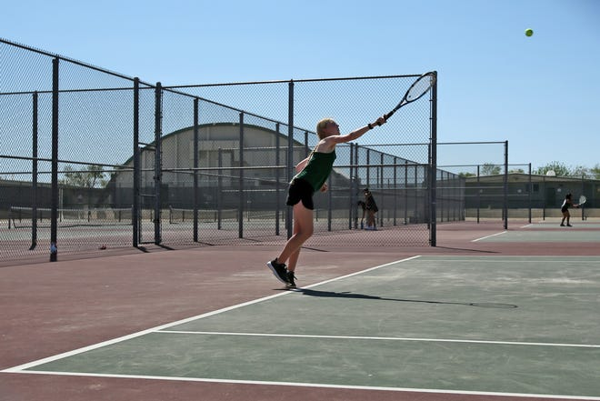 Alyssa Workman serves against Sultana's No. 1 singles player Monday afternoon.