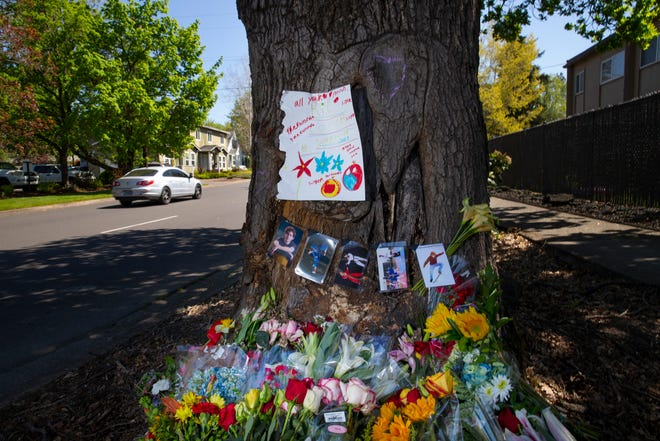 A memorial for a young man who died when his car struck a tree at 23rd Avenue and Patterson has grown since the accident.