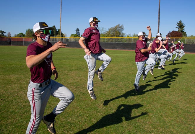 Willamette's Dane Woodcook, center left, warms up with teammates.