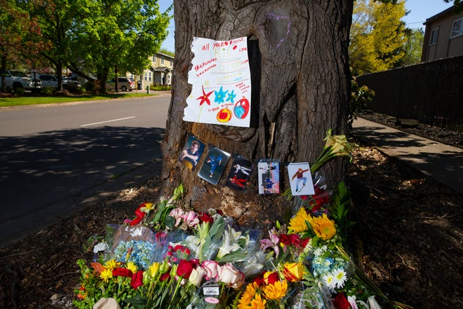 A memorial at 23rd Avenue and Patterson Street for 17-year-old Connor Truax of Eugene has grown to include handwritten notes and pictures. Truax died Monday when the car he was driving struck a tree. Four teenage passengers were also injured in the crash.