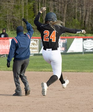Marlington's Angela Cirone celebrates as the umpire signals a home run on a ball she hit out during a game at Minerva on Tuesday, April 20, 2021. Cirone went 5-for-5 in the game. (Special to The Canton Repository / Bob Rossiter)