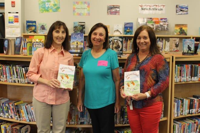 From left, Lisa Barnett, media specialist at Crookshank Elementary School; author Joanne Marziani; and Cassandra Branaum, assistant media specialist at Crookshank.