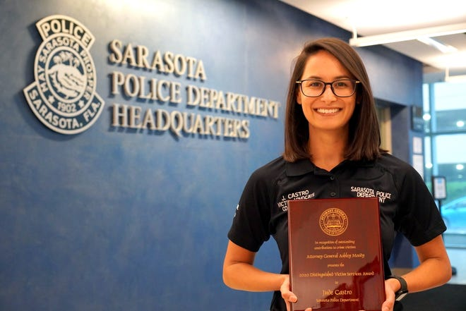 Sarasota Police Department Victim Advocate Jude Castro receives the Attorney General's Distinguished Victims Services Award on Wednesday in a virtual ceremony.