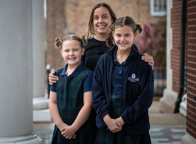 Donna Skelton, center, moved her daughters Addison, 8, left, and Adrianne, 10, right, to St. Aloysius School from the Ball-Chatham School District for in-person learning during the COVID-19 pandemic. [Justin L. Fowler/The State Journal-Register]