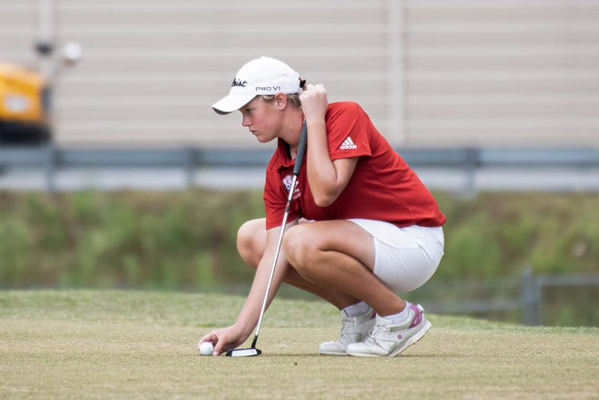 Savannah Christian freshman Mary Miller lines up her shot to putt during the annual City of Savannah High School Golf Championship on April 20 at Bacon Park Golf Course. Miller won the girls individual title with a 1-over 36 for nine holes.
