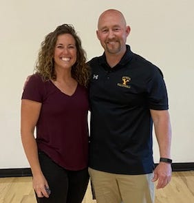 Volleyball coaches Melissa Church and Scott Eastman before their game last Wednesday.