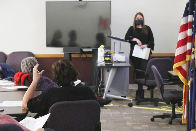 St. Joseph County ISD Superintendent Teresa Belote, left, discusses the Humanex survey results with Angie Tesman, who presented the findings Monday at the ISD board meeting.