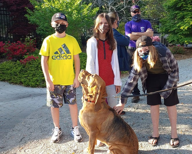 "Pictured from left, Jerod Smith, Beatrice Vaughan, and Stone Sheffield-Troiano members of New Hanover County 4-H Teen Leaders, congratulate BSAR bloodhound Otis after he used his nose to find one who became ""lost"" from the group."